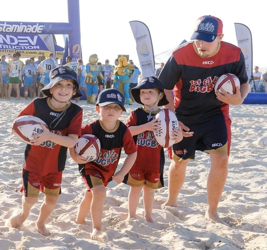 Kids Playing Rugby at the Beach