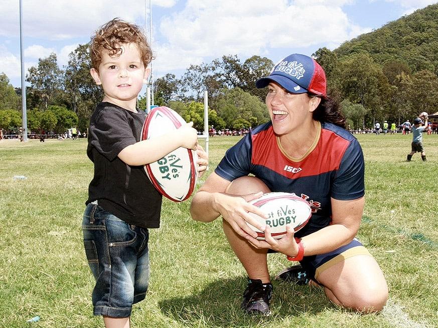 Female Rugby Coach with Boy in Gold Coast